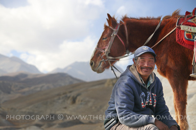Horse and horseman in Upper Mustang