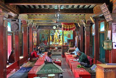 Monks inside Hiranya Varna Mahavihar in Patan