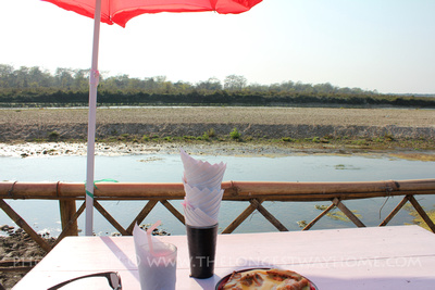 Having a meal beside the river in Chitwan