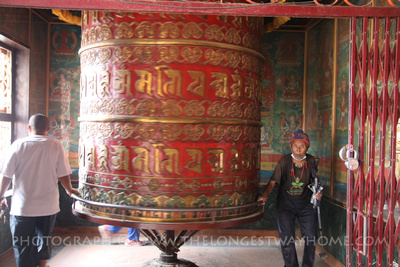Large prayer wheel on the ground floor of Tamang Gompa