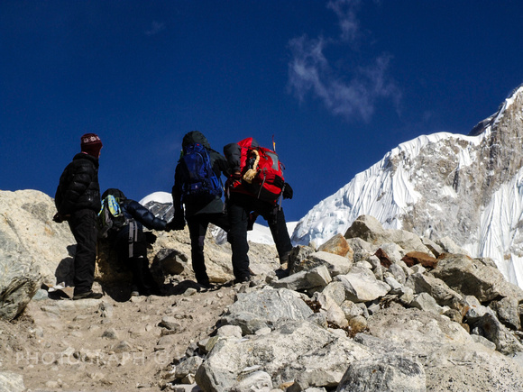 Trekkers struggling up a steep mountain on the Everest Base Camp Trek
