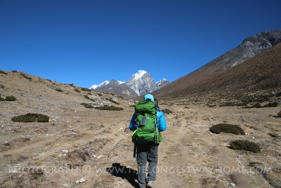 Trekker heading towards mountain
