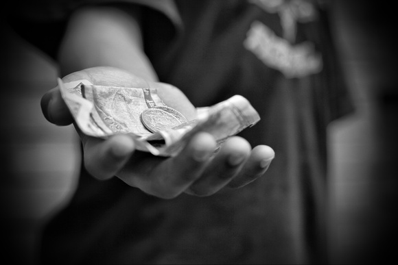 Boy's hand with Nepali rupees