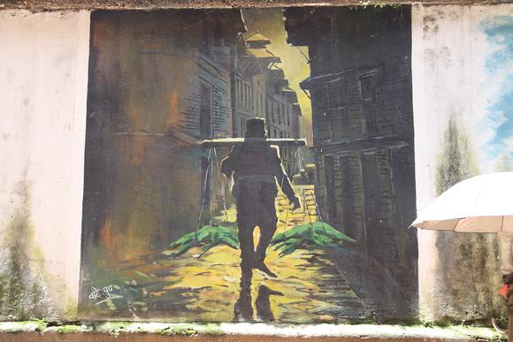 Street Art of an old man walking away ...