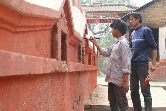 Men painting one of the prayer walls in Kankeshwori