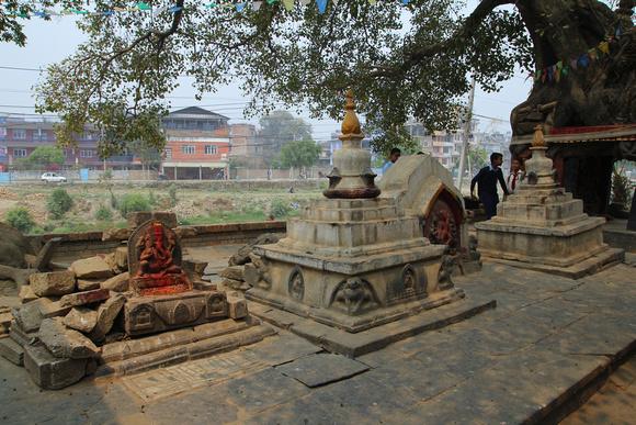 Ganesh statue, chiatya and Durga tree shrine at the Kankeshwari temple