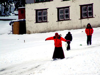 Young monks snowboarding in Nepal