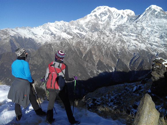 Two trekkers looking at mountains in Nepal