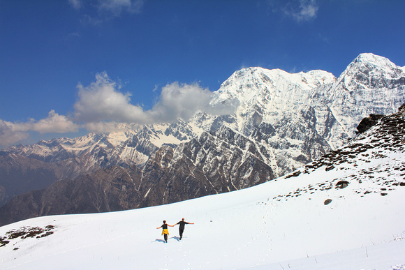 Trekkers holding hands while trekking in Nepal