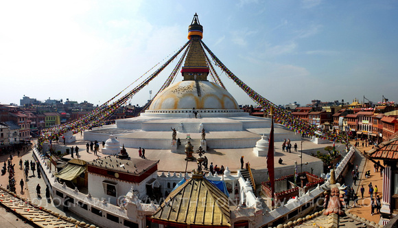 Boudha-nath in Kathmandu with the roof of the Ajima temple
