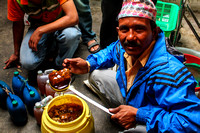 Honeycomb seller from Nepal