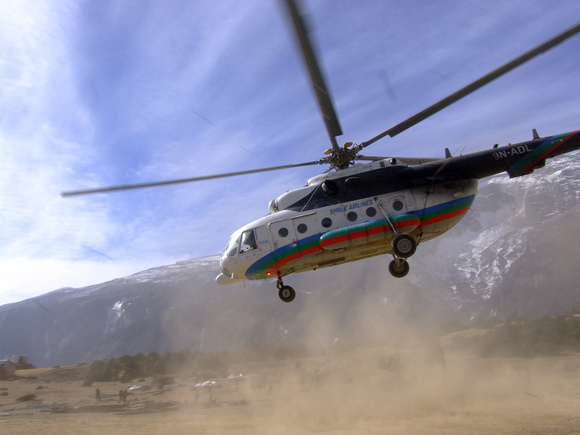 Helicopter taking off above Namche Bazaar