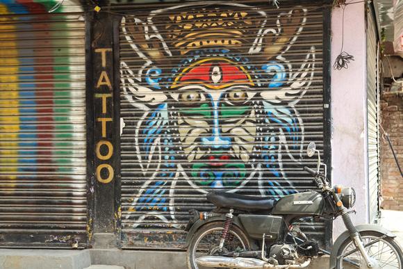 Street art on a metal door shutter in Kathmandu
