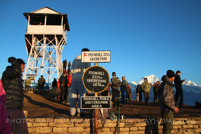 Viewing tower and crowd at the top of Poon Hill
