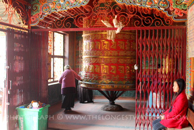 spinning large prayer wheel at Tamang gompa in Boudhanath