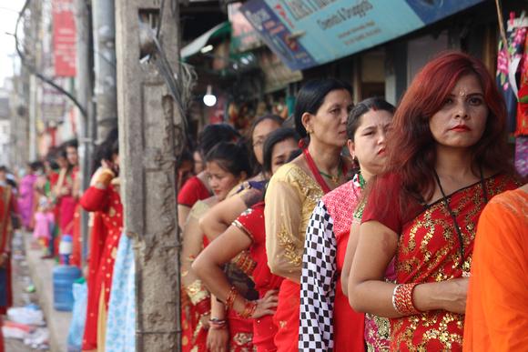 Women queuing during Teej