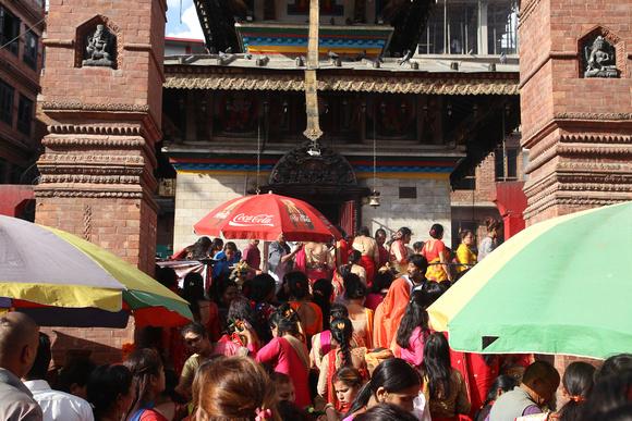 Women having blessings at a temple in Kathmandu for Teej