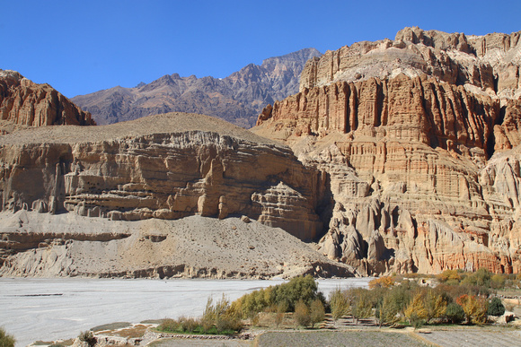 Orchards, horse and mountains around Chhusang in Upper Mustang