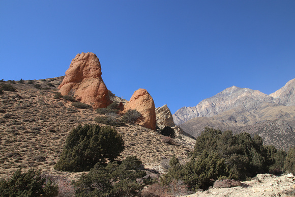 Red pinnacle shaped rock formation near Ghyakar in Upper Mustang