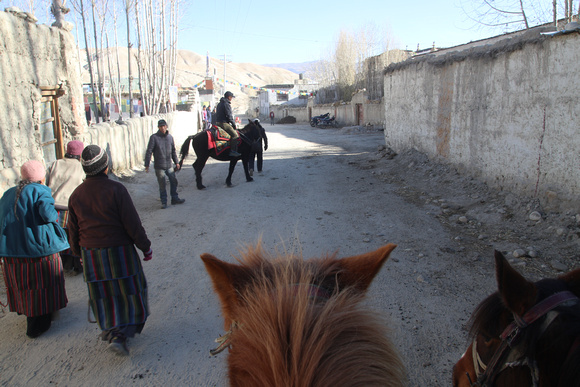 Getting on horses in Lo Manthang