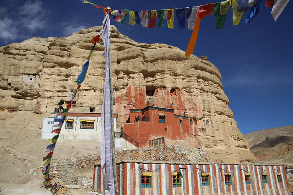 Lo Nifu Gompa with a candy colored buidlin below