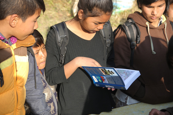 School girl reads a Nepal guidebook