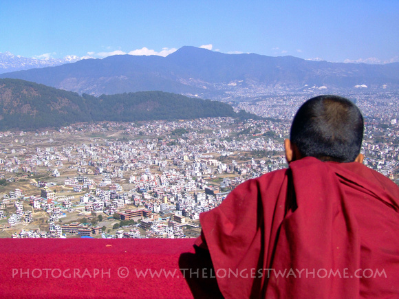 Young monk looking out over the Kathmandu Valley