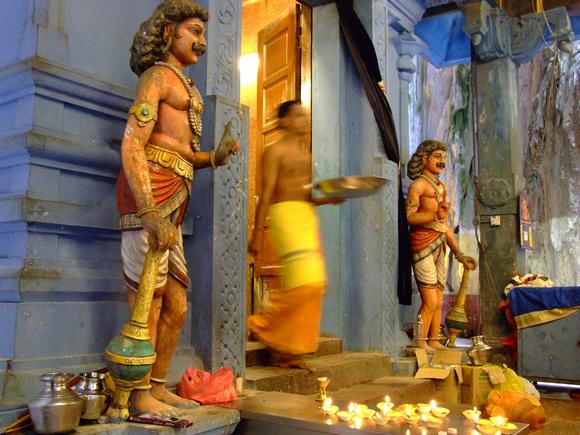 Brahmin (Hindu priest) carrying blessing at a Batu cave temple