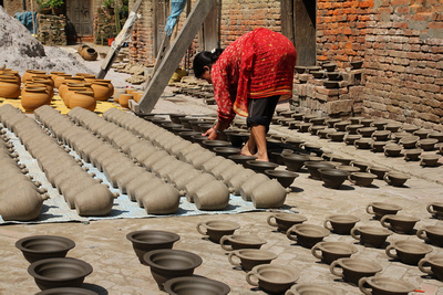 Women tending to pottery in Thimi