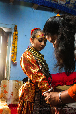 Kumari being dressed in ceremonial attire