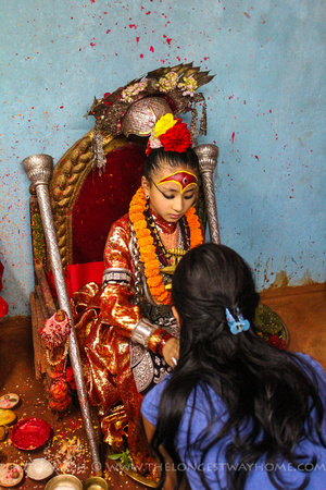The Kumari giving a blessing to a Newari lady