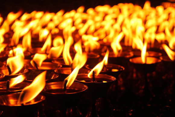 Close up of candles at night in Boudhanath