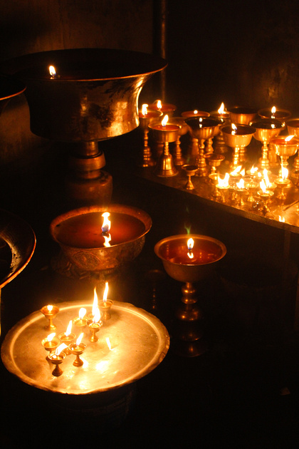 Candle holders at night Inside the monastery at Boudhanath