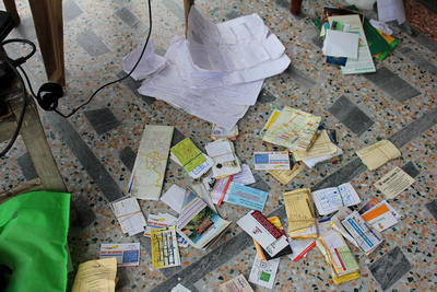 Business cards on the floor being used to compile data for a guidebook