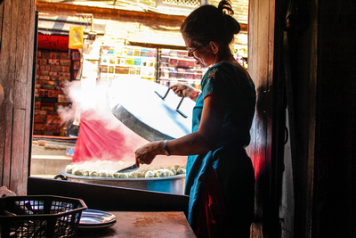 Nepali woman making momos