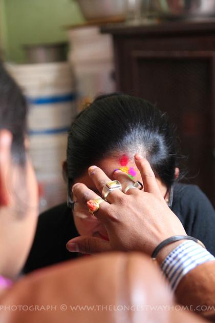 A brother gives his sister a tika on Bhai Tikka