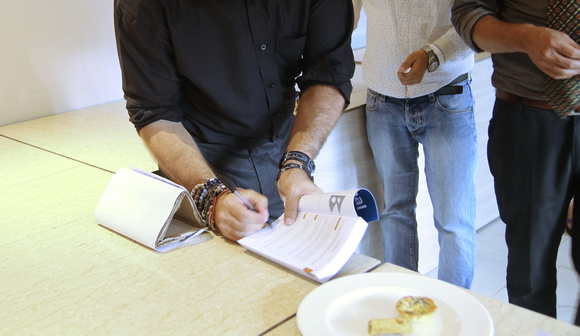 Signing books at the book launch
