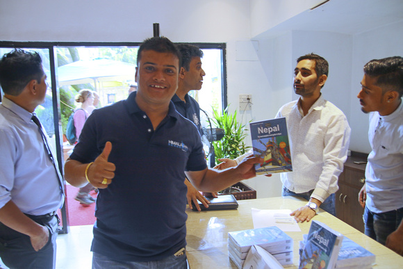 Happy man with a Nepal guidebook