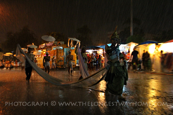 Performer at Loi Krathong in the rain