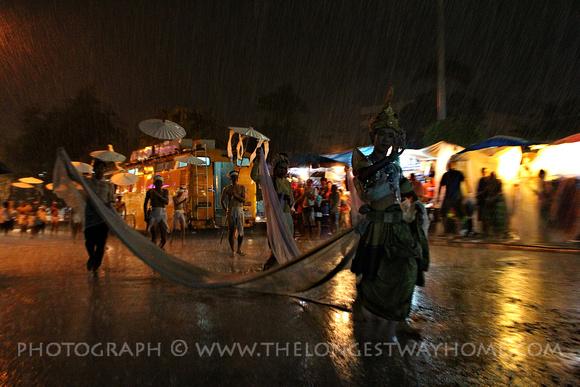 Performer at Loi Krathong in the rain