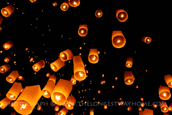 Sky lanterns in the night sky at Yee Peng