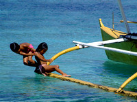 Children playing on a tropical boat