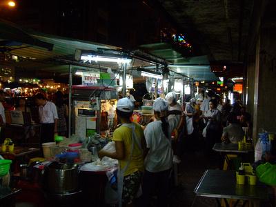 Roadside cooks in Chinatown Bangkok