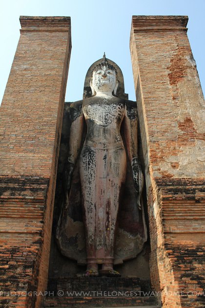 Standing Buddha beside the Chedi at Wat Mahathat,