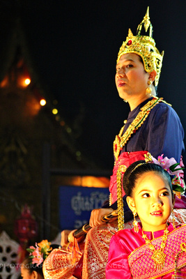 Thai man and girl dresses in traditional costumes