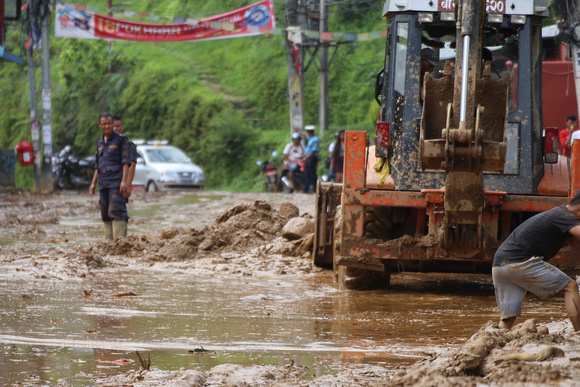 Clearing a road in Nepal during monsoon season
