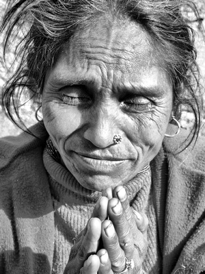 Nepalese lady saying namaste