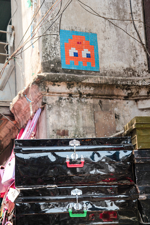 A space invader above a market stall in Ason