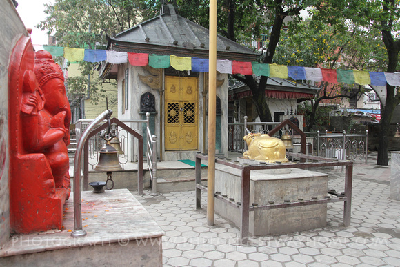 Main Shiva shrine in north Thamel with a brightly painted Ganesh statue in the courtyard.