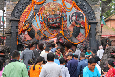 People gather around the Bhairab statue in Kathmandu Durbar Square for a puja (blessing)
